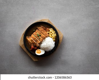 A Japanese katsu curry on a grey table for use in food advertising and menu boards.