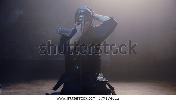 Japanese Kendo fighter is preparing to fight.