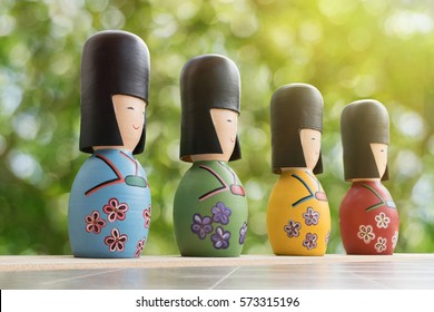 Japanese Kokeshi Dolls with green bokeh background