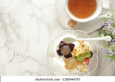 Japanese kyoho grape and granola with yogurt for gourmet breakfast image