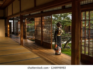 Japanese lady wearing kimono in sunset lightning