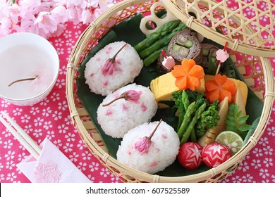 Japanese lunch box in bamboo basket for cherry-blossom viewing