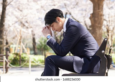 Japanese male businessmen who are troubled by worries