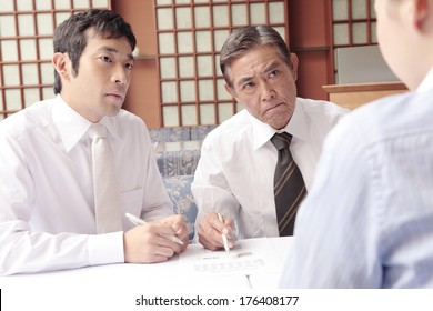 Japanese males in a meeting