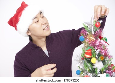 Japanese man decorating the tree