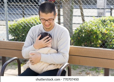 A Japanese man holding a child