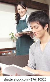 Japanese man reading a book