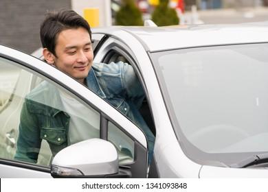 japanese man riding car