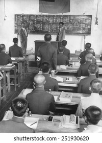 Japanese in Manchukuo create a new 100,000 police force in 60 days. Japanese instructors from Tokyo drill peasants in reading fingerprints. The instructor has an interpreter.