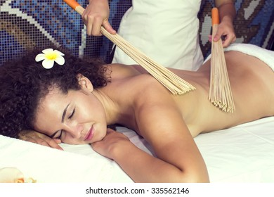 Japanese massage with bamboo sticks in the spa salon
