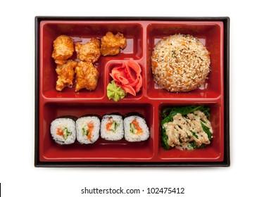 Japanese Meal in a Box (Bento) - Chuka Salad, Fried Rice with Veggies, Sushi Roll, Tori Karagi (breaded chicken)