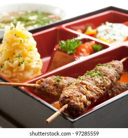 Japanese Meal in a Box (Bento) - Salad, Skewered Meat and Mashed Potato and Dessert