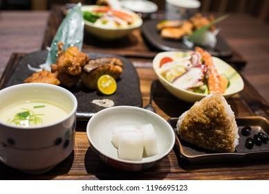 Japanese meal set, combo meal(onigiri, karaage, grilled salmon, seafood salad, steamed egg)