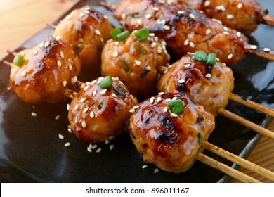 japanese meatball grill  or tsukune cooked with teriyaki sauce ready to eat photo in studio lighting.