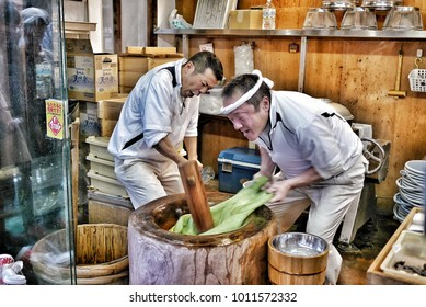 The Japanese men are mochi pounding that is super fast at Nakatanidou in Nara, Japan on 24 November 2016