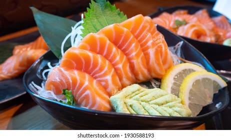 Japanese Menu - Salmon Sashimi served with wasabi and lemon