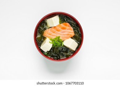 Japanese miso soup with salmon and tofu cheese  on the white background top view.