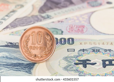 Japanese money 10 yen coin on banknote close-up