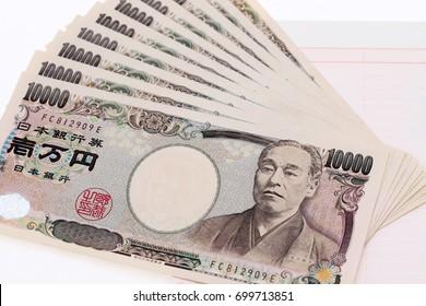 Japanese money and bankbook isolated on white background?