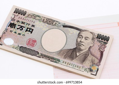 Japanese money and bankbook isolated on white background?