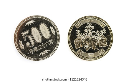 Japanese money, metal coins on white background. 500 yen, JPY currency, macro view. Finance, banking and business in Japan concept.