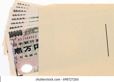 Japanese money in salary envelope on white background