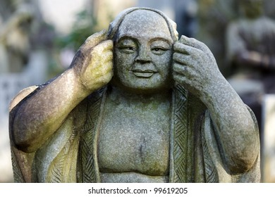 japanese monk stone statue in Kyoto