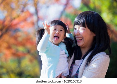 Japanese mother and daughter playing in the park