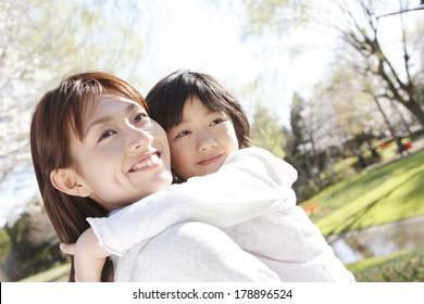 Japanese mother hugging her daughter