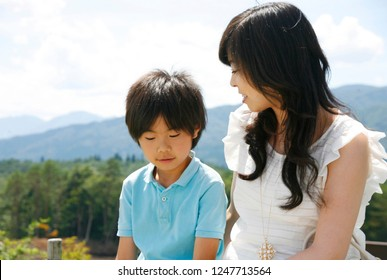 Japanese mother and son who are on the plateau
