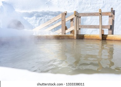 Japanese natural mineral hot spring water Onsen cover by snow in winter with steam or mist.Ice Igloo Village at Lake Shikaribetsu,Hokkaido,Japan