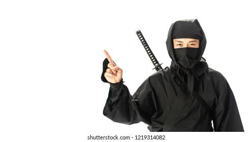 Japanese Ninja pointing at white space.