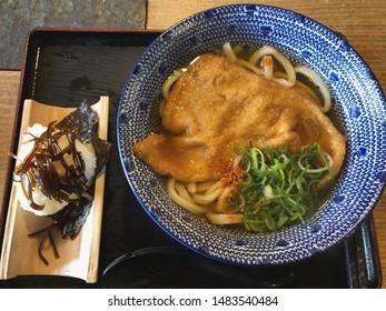 "Japanese noodle called ""Udon"" with rice bowls ""Onigiri"" with seaweed ""Kobu""."