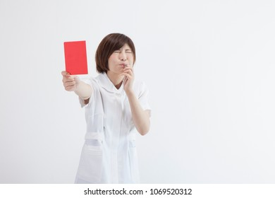 Japanese nurse with a red card