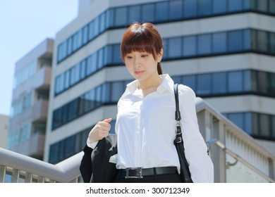 Japanese office lady in a town
