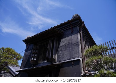 """Japanese old architecture with black wall and wood window at Sawara, Japan.  Sawara is tourist site as it remains old architecture called """"Koedo"""" which means """"Small edo"""". Edo is Japanese old era."""