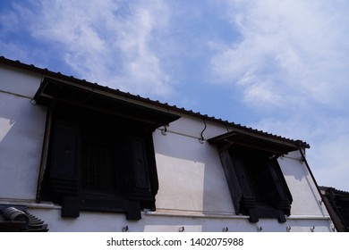 """Japanese old architecture with white wall and black window at Sawara, Japan.  Sawara is tourist site as it remains old architecture called """"Koedo"""" which means """"Small edo"""". Edo is Japanese old era."""