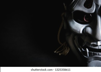 Japanese oni mask or giant mask, used to decorate handmade from original to make it look dark and art, with half of the face then look more scary