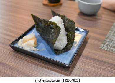 Japanese Onigiri -  Japanese food made from white rice formed into triangular or cylindrical shapes and often wrapped in nori (seaweed).