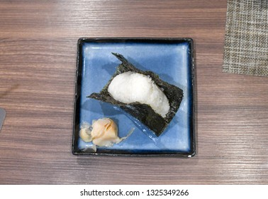 Japanese Onigiri -  Japanese food made from white rice formed into triangular or cylindrical shapes and often wrapped in nori (seaweed). flat lay .