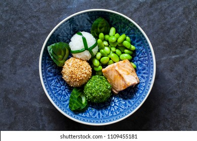 Japanese onigiri sushi rice balls with salmon and soy beans