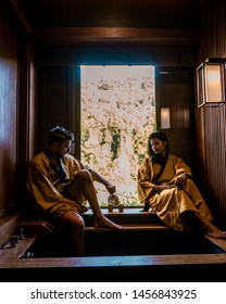 Japanese Onsen Spa, couple men and woman drinking thee Onsen Spa, japanese onsen bath in Thailand