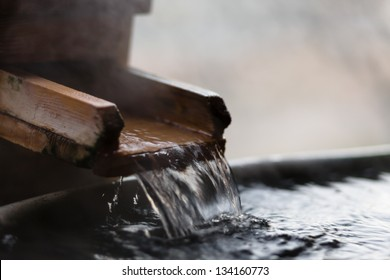 Japanese open air hot spring (focus on the flowing water)