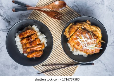 Japanese Oriental Cusine; Rice with teriyaki chicken grilled and tonkatsu don in Japanese style set and ready to eat in studio lighting. Teriyaki sauce juicy chicken decorated in simple concept.
