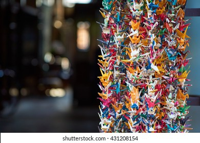 Japanese Origami papers - hundreds of folded origami cranes in a temple