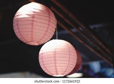 Japanese paper lanterns.Blured background. Beautiful shot. Pink sacura concept.