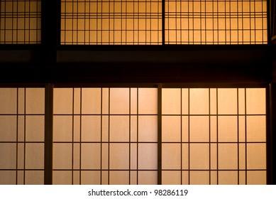 Japanese paper sliding door dyed orange at sunset