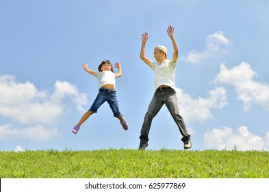 Japanese parent and child jumping