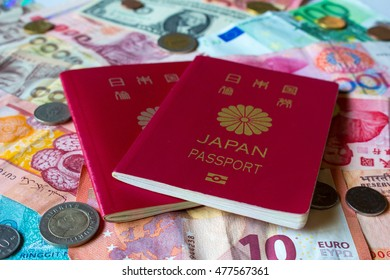 Japanese passport and world currency - Shutterstock ID 477567361