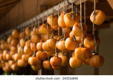 Japanese peeled persimmons being dried in the sun